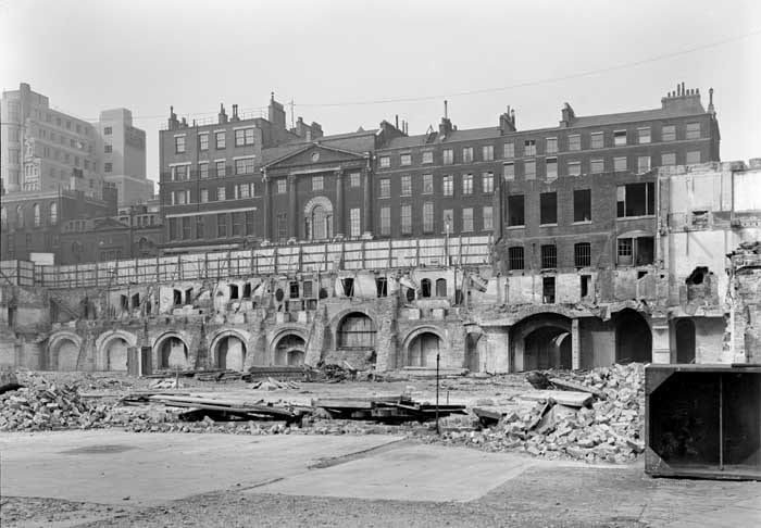 11 The remains of the demolished Adelphi Terrace, 1936 (buildings in John Adam Street beyond). Historic England Archive photograph (AA65/00065)