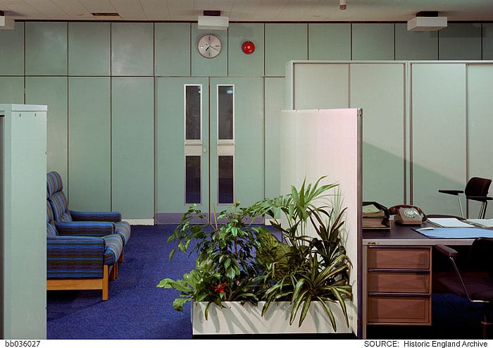 Storage cabinets and plants defined spaces within the open-plan layouts. Photographed by Millar & Harris c. 1974 © Historic England Archive, bb036027