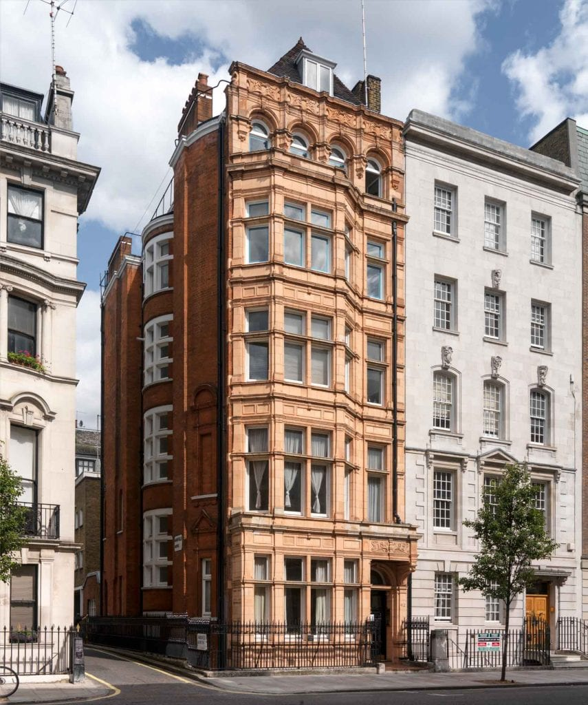 40 and 42 Harley Street show the contrasting architectural taste of the 1890s (No. 42 on the left, by C. H. Worley) and 1930s (No. 40 on the right, by Charles W. Clark, architect to the Metropolitan Railway Company). No. 40 was designed to resemble a private house but provided suites of consulting rooms behind a modish Art Deco entrance hall. No. 42 decked in Worley's characteristic orange-pink terracotta was given Jacobean-style interior decor.