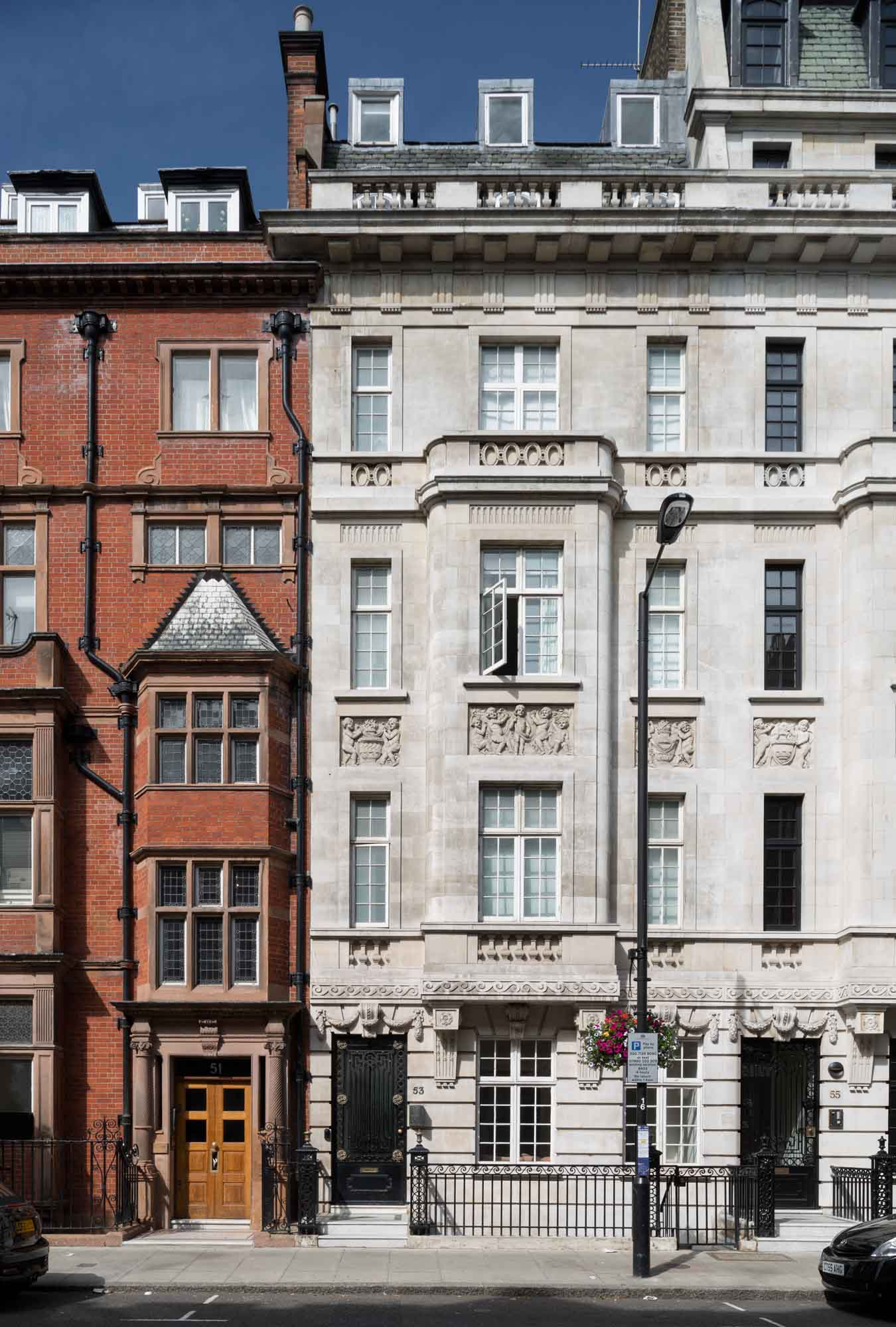 Nos 51 (left) and 53 Harley Street. No. 51was built in 1894 to designs by F. M. Elgood for the surgeon William Bruce Clarke on the site of the Turk's Head pub. No. 53 was designed by Wills & Kaula and completed in 1914-15 as a home and practice for the surgeon and urologist Frank Seymour Kidd.
