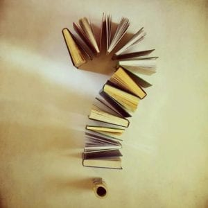 Books in a question mark shape