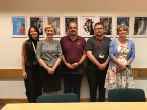 Mohammed Jasim (centre) with BL colleagues Eleanor Cooper, ..., and Daniel Lowe, and Nahrein Network director Eleanor Robson