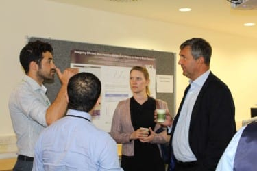 Jonathan Dale (right) talks with attendees at UCL in the Middle East