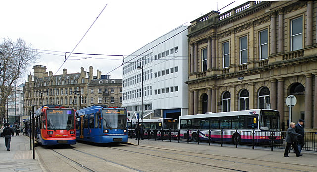Image of trams and bus