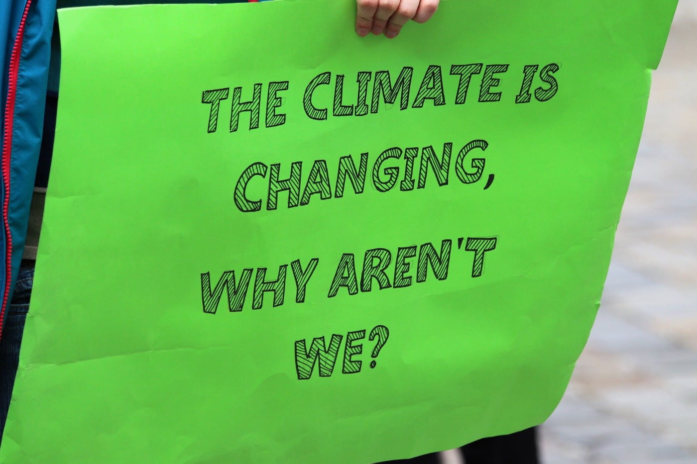 "A sign with the words, ""The climate is changing, why aren't we?"""