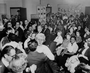 Title: ILGWU Local 25 couples enjoy social dancing at the ILGWU Workers University, April 18, 1955. Arthur W. Calhoun is present. Image from the Kheel Center.