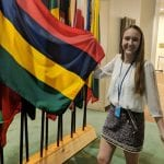 Global Intern in USA holding a flag