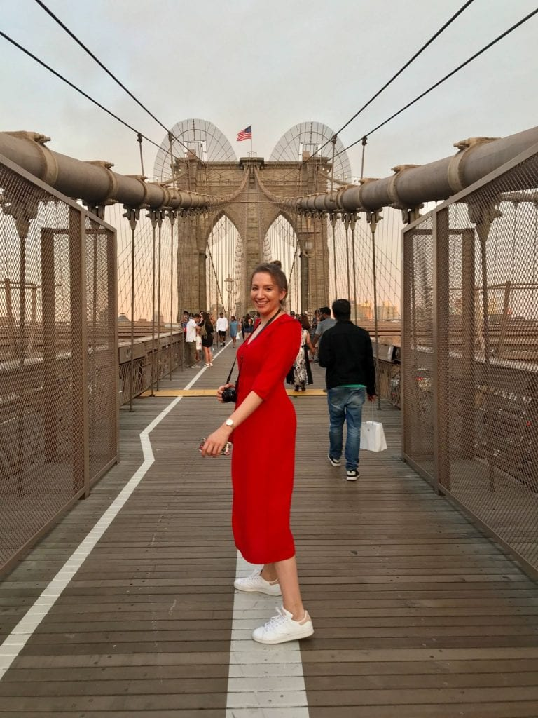 Magali standing on the Brooklyn Bridge