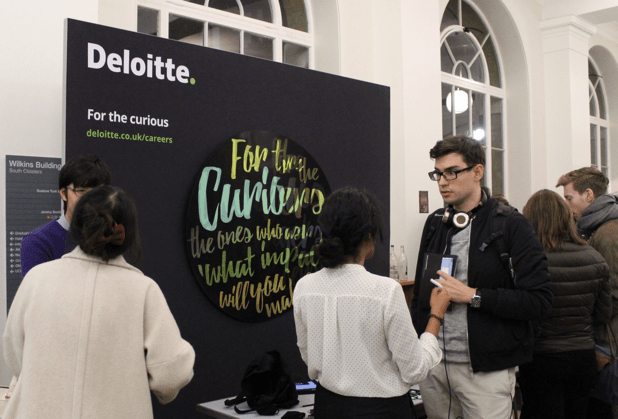 Image of a student talking to an employer at a careers fair