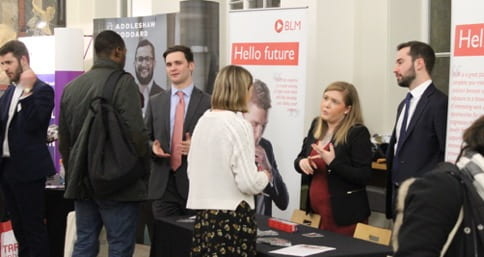 Students talking to employers at a UCL Careers fair