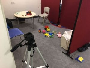 The picture shows the setting of an ADOS: participants were asked to play with different toys and their responses were noted down and later assessed by an ADOS-trained expert.