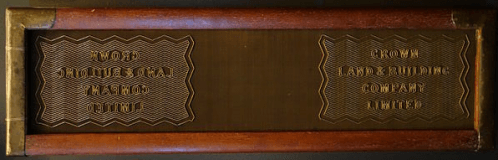 A wove mould, featuring two large watermark designs. Between the watermarks the smooth surface of the woven screening is visible, which leaves the paper with a fabric-like textured appearance, without the prominent horizontal and vertical lines of laid paper. (Image credit: Wove mould made by J. Brewer, London, England - Robert C. Williams Paper Museum, CC0 1.0)