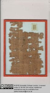 Remains of papyrus showing the division of 2, written in Hieratic script.