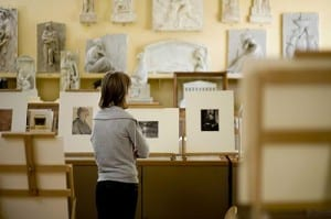 A student views works on display at UCL Art Collections