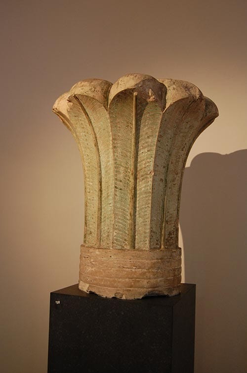 Palm leaf column capital.