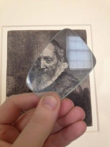 A portrait by Rembrandt examined through a magnifying glass