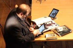 Dr Emmett Sullivan studying his iPads and his books during a break in filming