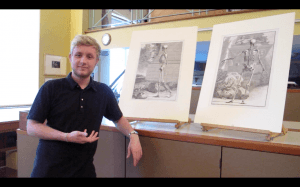 UCL Student Tom Cowie stands in front of two 18thC anatomical prints from the Art Museum's collections