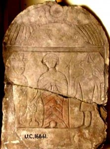 A roman stele with the scarab at the top