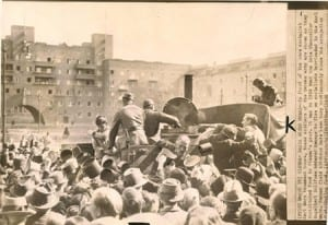 This photo is a wire photo: It shows the Nazis using the Karl-Marx-Hof as a politically laden backdrop to their feeding station for the starving Viennese