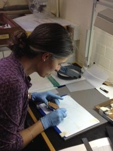 Dr Joanne Rowland in the Petrie Museum in October 2013 studying pottery from Merimde