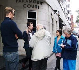 Kevin Guyan speaking with participants on his Bloomsbury walking tour, outside Paramount Court