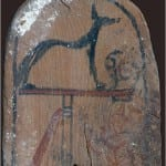 A wooden stela depicting Wepwawet