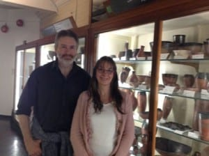 Guy Funnell and Amanda Hawkins in the Petrie pottery gallery beside Predynatic black-topped pottery.