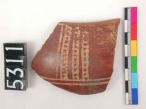 "Pottery piece: Rim sherd with red polished surface and white painted decoration (Petrie's ""Cross-Lined ware"" C-Ware)"