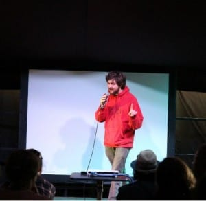 UCL researcher performing at Bright Club at the Green man festival