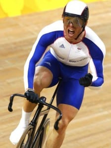 Sir Chris Hoy cycling in Team GB kit in a velodrome