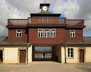"Buchenwald concentration camp. The clock above the entrance permanently records the time of the camps liberation - 3.15. "" Buchenwald - Concentration Camp Gate "" by Andreas Trepte - Own work . Licensed under CC BY- SA 2.5 via Wikimedia Commons."