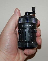 "Curta Calculator - ""Curta01"" by Larry McElhiney - Created this image in Indianapolis, IN. Licensed under CC BY-SA 2.5 via Wikimedia Commons"