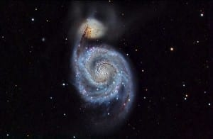 The Whirlpool Galaxy lies 30 million light-years away.   It was the first galaxy in which spiral structure was discovered in 1845.
