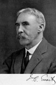 Black and white image of the head and shoulders of James Cossar Ewart