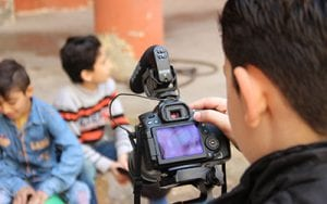 One of the children supported by the Refugee Film Project films his friends