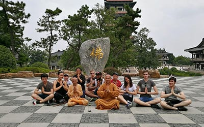 students and monks during temple visit