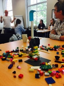 Building a Lego tower in teams