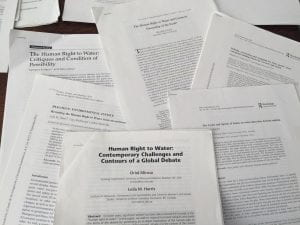 Academic papers in a pile