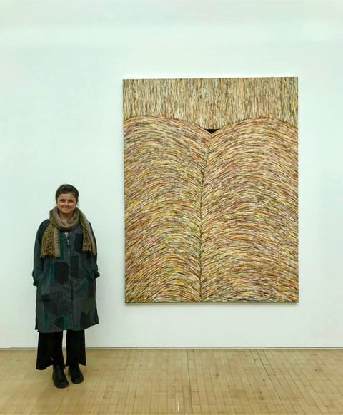 Gabriela Giroletti standing in front of painting at Bloomberg New Contemporaries 2019