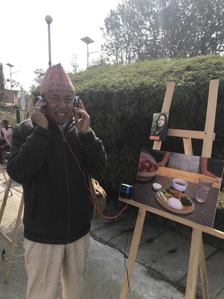 Nepalese man listens to recroding of Diebates experience