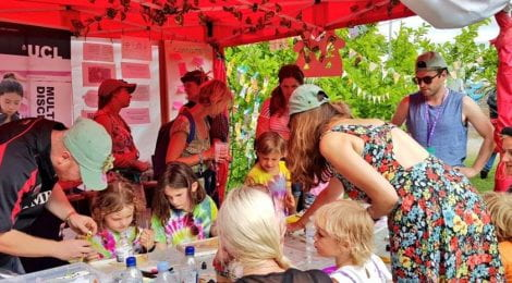 Festival goers try out the science activities in a tent