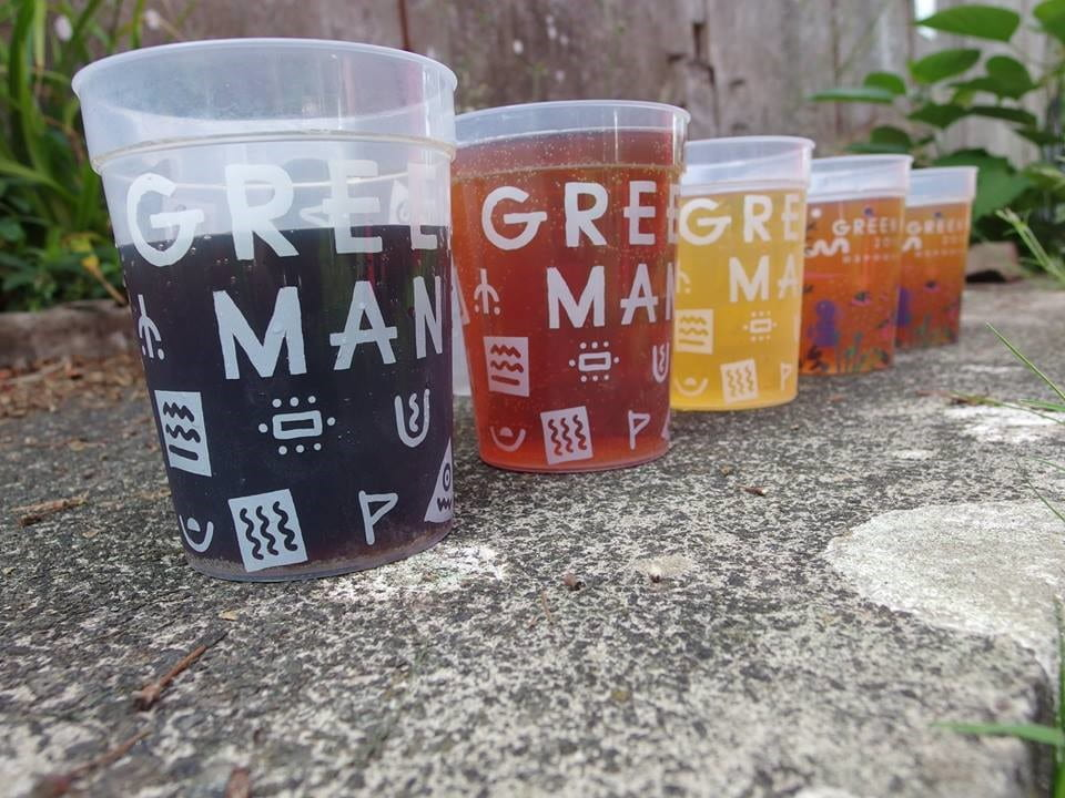 several beers lines up in green man festival branded glasses
