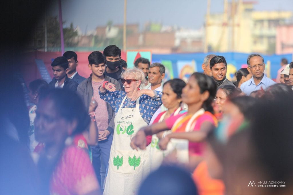 Crowd of onlookers as women dance at the mela
