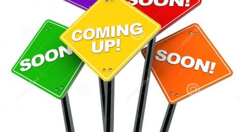 """Colourful signs say """"soon!"""" and """"coming up!"""""""