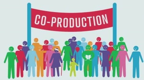 "A group of smiling stick figures under a banner that says ""Co-production"""