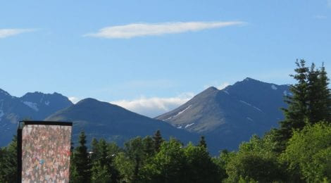 A picture from Rachel's trip – beautiful mountains in Alaska with a sign for Southcentral Foundation.