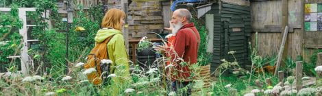 two participants of an engagment project talking in a garden