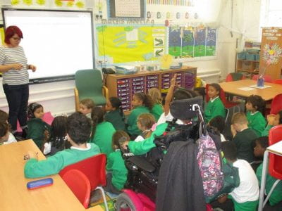 Image of Sarah leading workshop with primary school students.
