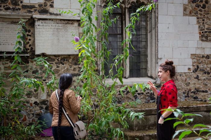 Artist Rubbena talks to her BSL interpreter outside Bow church